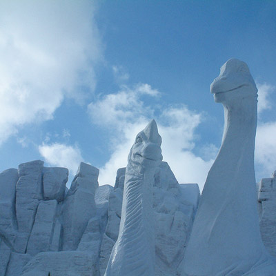 dinosaur snow carving
