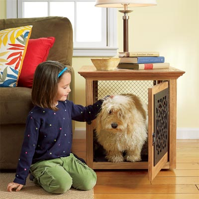 girl with dog in front a training crate you can build as a pet-friendly project