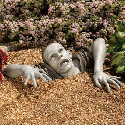 handmade zombie sculpture as one of the wackiest yard and garden products