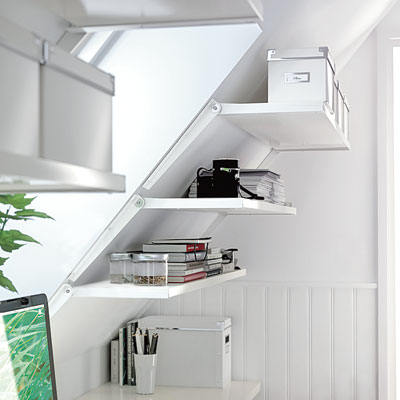A slanted wall shelving unit