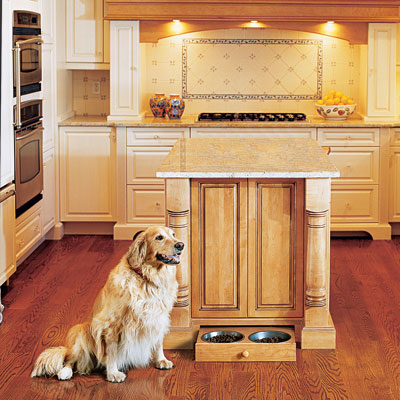 Kitchen with a pull-out pet feeder in cabinet toekick