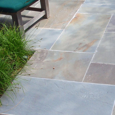 Replace plastic with stone patio blocks