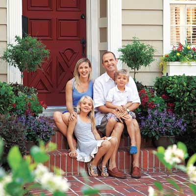 The Rader family on the front steps of their colonial home