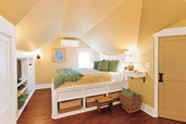 Yellow attic bedroom after remodel