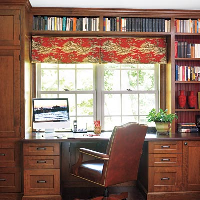 Home office with built-in shelving unit