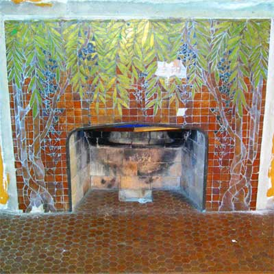 A fireplace surround by artist Orlando Gianni in this saginaw michigan queen anne victorian from save this old house