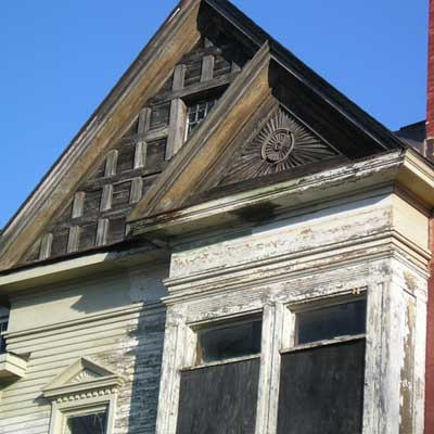a double gable on the side of  this saginaw michigan queen anne victorian from save this old house