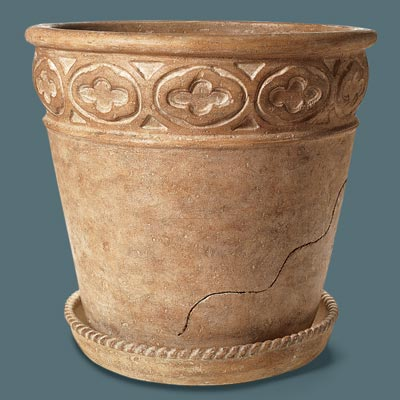 faux stone urn with a cup and saucer design