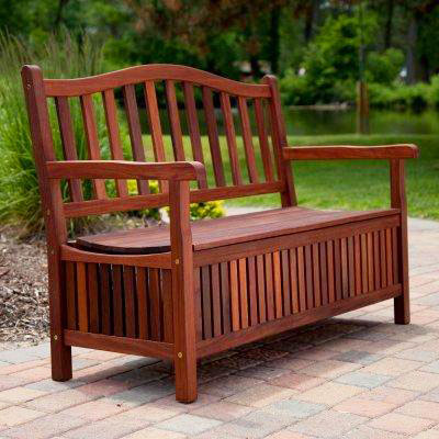 Wooden storage bench pictured on patio