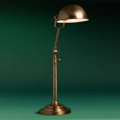 a steel with antiqued-brass finish free-standing pharmacy lamp