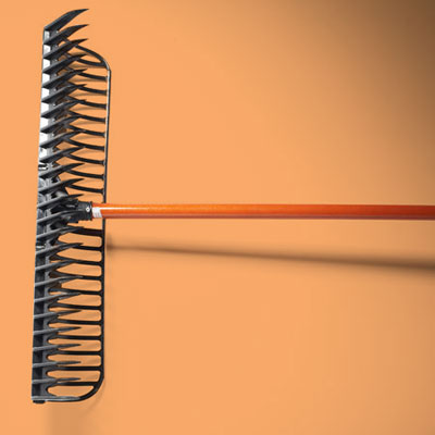 a flat steel rake with wooden handle