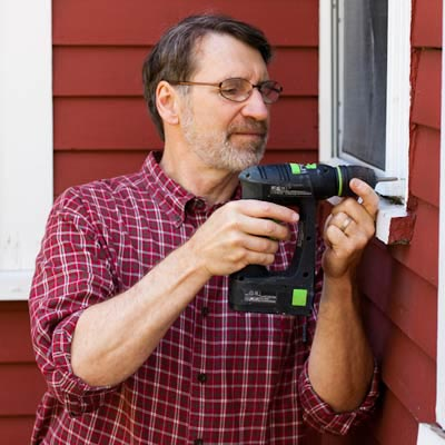 Norm Abram using a cordless drill/driver
