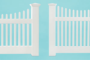 comparison shot of two vinyl picket fences from different price ranges