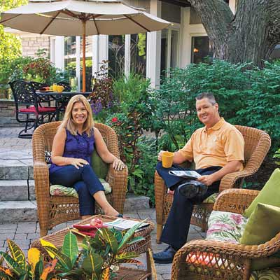 man and woman sitting on outdoor patio