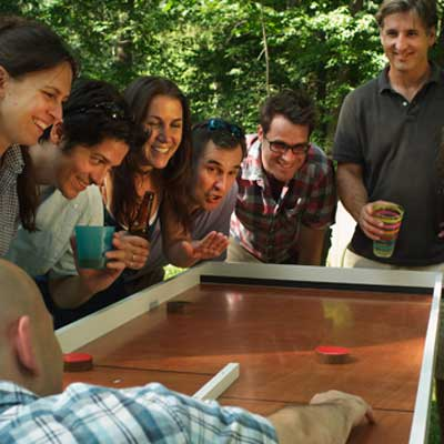 group of people playing ricochet game in backyard