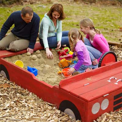 build a sand box shaped like a race car for backyard games