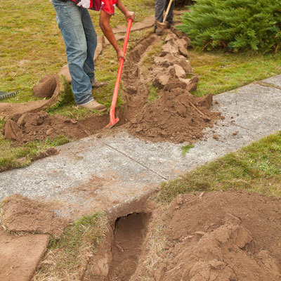Dig the inlet trench and lay plastic pipe for the garden area