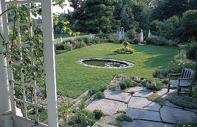 flagstone terrace, alpine plants and pond in Litchfield, Connecticut, garden