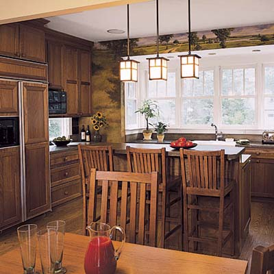the pendant lights illuminate the kitchen island perfectly while blending  seamless with the rustic dcor of this space