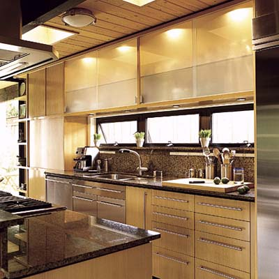 undercabinet and interior cabinet lighting combined with natural light in kitchen