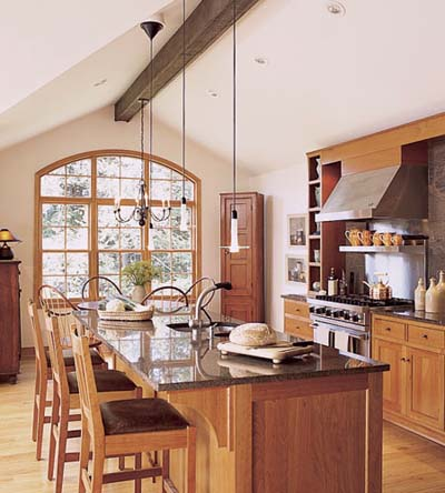 kitchen zones distinguished by lighting fixtures
