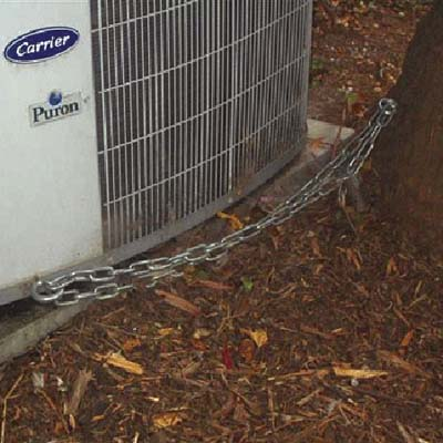 air conditioner chained to a tree