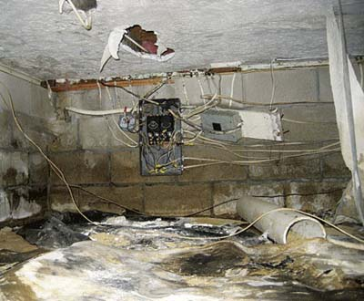 Basement crawl space with finished ceiling, ruined electrical, filled with dirt