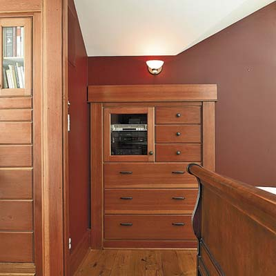 built-in storage in master bedroom of remodeled houseboat