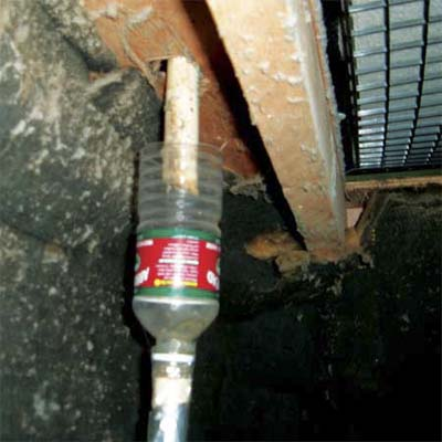 plastic water bottle used as a trap on a condensation line for a furnace