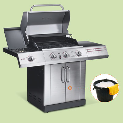 gas grill with inset of bucket with soapy water and towel