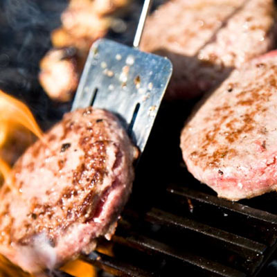 grilling light-colored meat on a gas grill