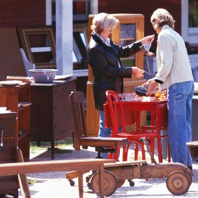 people shopping for vintage furniture at a flea market
