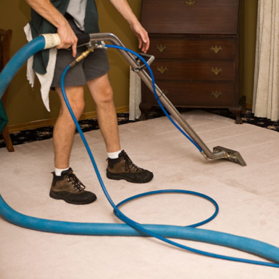 steam cleaner steaming and cleaning a carpet