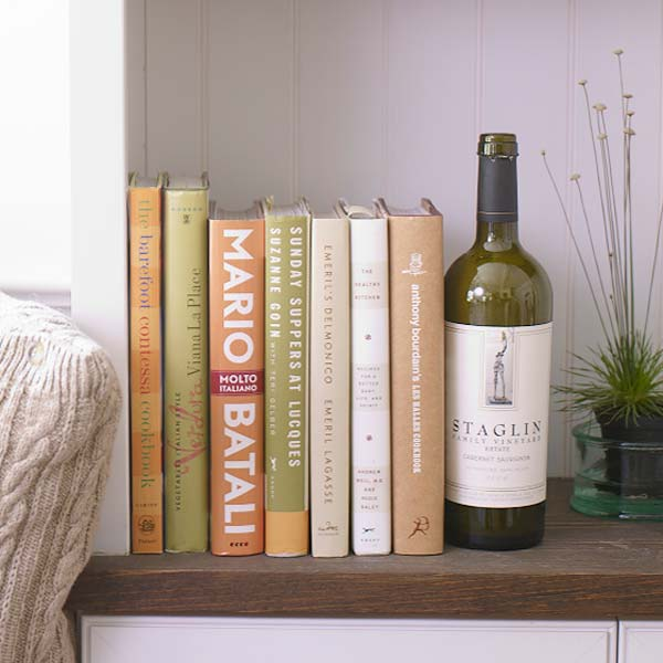 empty wine bottles used as book ends