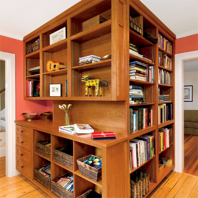 home office upgrade featuring built-in bookshelves a powder room and desk area