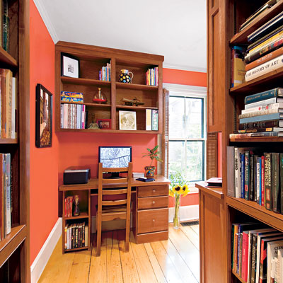 built-in bookshelves in this home office upgrade with desk area and powder room