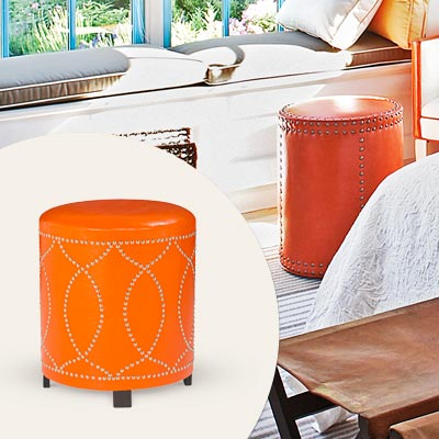 orange faux leather ottoman with nailhead trim