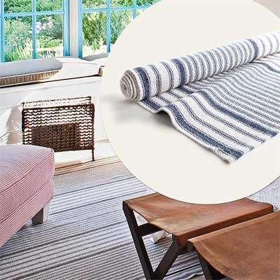 faded blue and white striped cotton rug