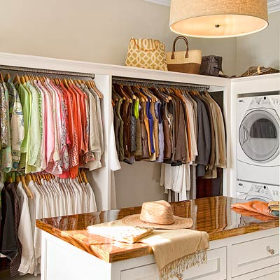 a laundry room and walk-in closet area