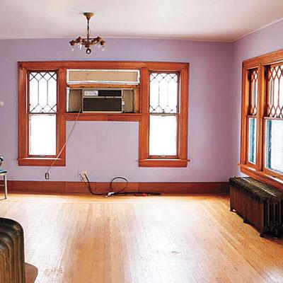 living room with mauve walls and golden Oak trim