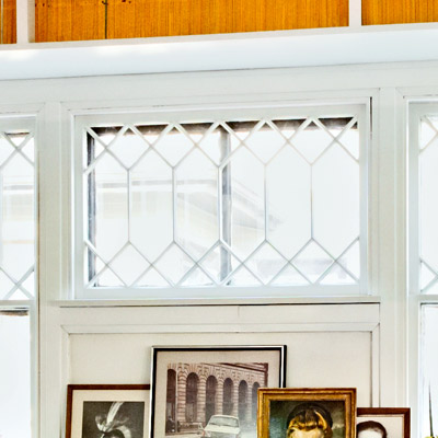 closeup of window with white trim and built-in bookshelves