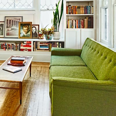 green vintage sofa and bench-style coffee table