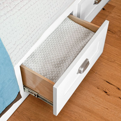 guest bedroom remodel with drawers in bed platform