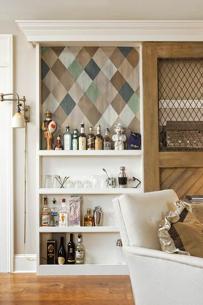 built-in bookcase used as a wet bar