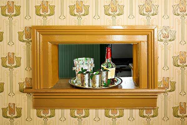 wall cutout that looks like window to serve as a wet bar