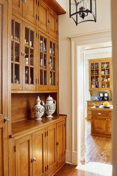built-in storage unit in house's hallway used as wet bar