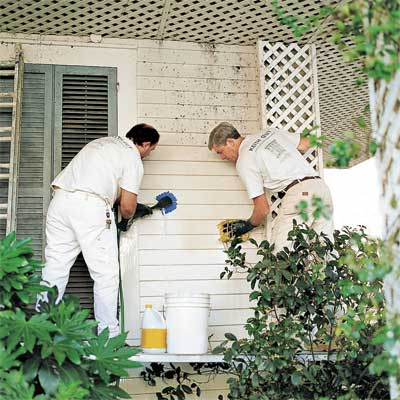construction workers cleaning fiber cement siding