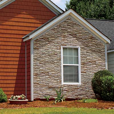 fiber cement siding panels made to look like stacked stone