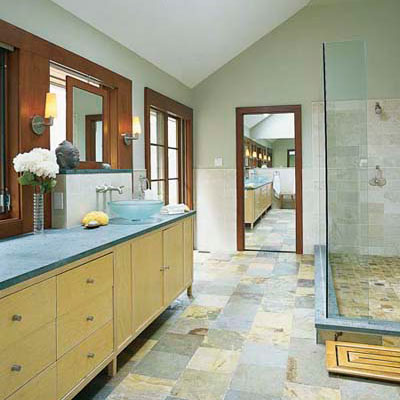 bathroom with blue stone countertop and multicolored floor tile