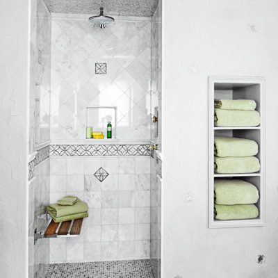 1930s Hollywood Regency-style bath with mosaic tile shower and gray textured plastic walls